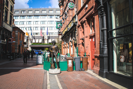 Dublin, Ireland - April 20, 2012 View on Harry Street from Grafton Street near Saint Stephens Street  A man with sunglasses is walking on the pedestrian street