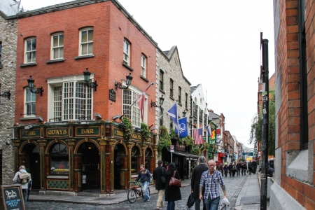 Dublin, Ireland - October 24, 2013 People are walking on a pedestrian street of Temple Bar, a very touristic area in Dublin