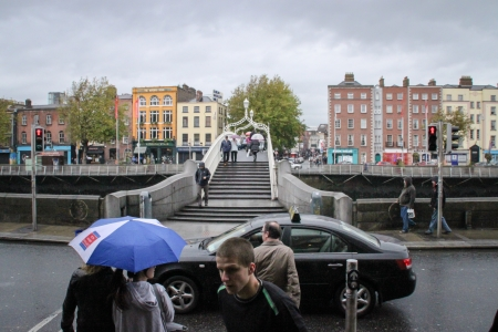 ha: Dublin, Ireland - October 23, 2011 Pedestrian are crossing the Liffey River through the Ha
