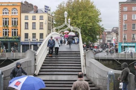 Dublin, Ireland - October 23, 2011 Pedestrian are crossing the Liffey River through the Ha