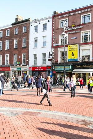 Dublin, Ireland - October 25, 2013 People are walking on the most popular street in Dublin, Grafton street near St Stephen
