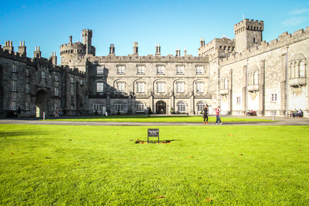 Kilkenny, Ireland - October 31, 2013 People are walking around a main tourist attraction in Ireland, the Kilkenny Castle  It is a castle who was built in 1195 by William Marshal