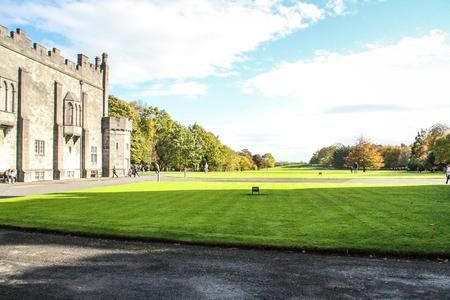 Kilkenny, Ireland - October 31, 2013 People are walking in the park of the Kilkenny Castle in Ireland