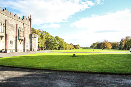 Kilkenny, Ireland - October 31, 2013 People are walking in the park of the Kilkenny Castle in Ireland