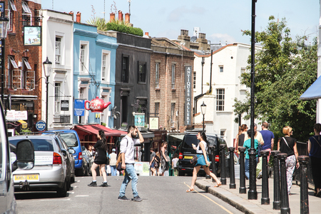 London, United Kingdom - July 24, 2013 People are crossing the Portobello Road in Notting Hill district located in west London  Editorial