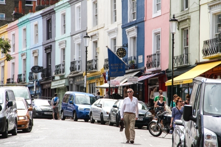 London, United Kingdom - July 24, 2013 A man is walking down Portobello Road in Notting Hill district located in west London