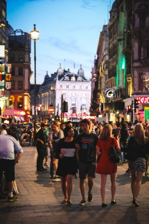 London, United Kingdom - July 24, 2013 People walking at Leicester Square et night  A the background we can see a part of the Piccadilly Circus  Stock Photo - 25219870