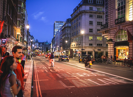 London, United Kingdom - July 24, 2013 A couple is waiting for to cross the Haymerket Street near Piccadilly Circus