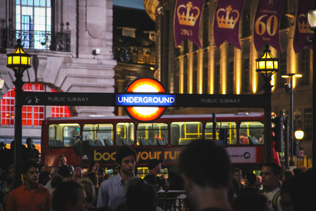 London, United Kingdom - July 24, 2013 People at the entrance of the Piccadilly Circus underground station at night