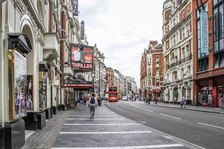 shaftesbury: London, United Kingdom - July 26, 2103 A tourist is walking on the Shaftesbury Avenue  Editorial