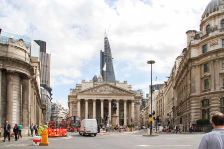 London, United Kingdom - July 26, 2013 People are walking on the sidewalk of the Bank of England near the Royal Exchange  Editorial
