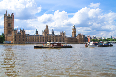 London, United Kingdom - July 26, 2013 Barges are sailing by the Parliament House and Big Ben on the Thames River in London  Editorial