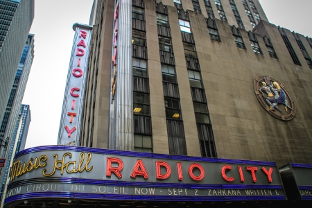 New York City, USA - August 8, 2012 Radio City Music Hall in Manhattan during  People and traffic can be seen around this iconic location