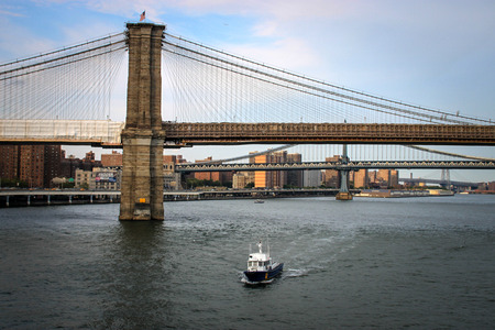 New York City, USA - August 12, 2012 A NYPD boat on the beat between the Brooklyn Bridge and Pier 17