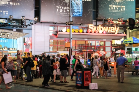 New York, USA - August 12, 2012 People are walking on the sidewalk in front of the entrance of Times Square - 42 Street subway station  Editorial