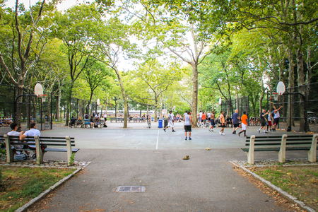 New York, USA - August 12, 2012 Men are playing basketball in Central Park