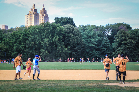 New York, USA - August 12, 2012 People practicing baseball in Central Park