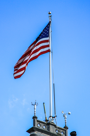 American flag on the top of a building  Stock Photo