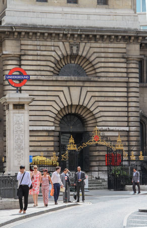 London, United Kingdom - July 26, 2013 People are standing in front of the entrance of  the Saint Mary Woolnoth Church of England