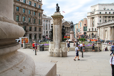 London, United Kingdom - July 26, 2013 People are walking in front of the Royal Exchange