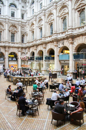 London, United Kingdom - July 26, 2013 Inside the Royal Exchange people are enjoying lunch or coffee break  Editorial