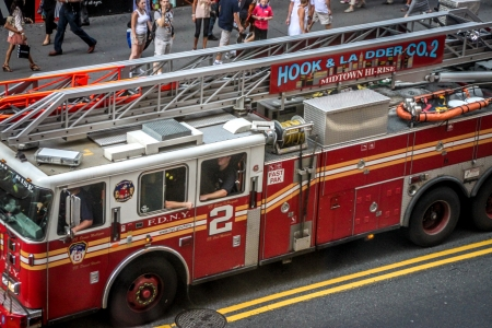 New York City, USA - August 7, 2012 A fire truck is rushing on the W 42nd St near Times Square