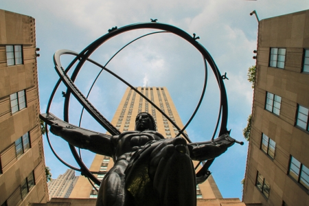 New York City, USA - August 8, 2012 Atlas, the bronze statue in front of Rockefeller Center in midtown Manhattan, New York City, across Fifth Avenue from St  Patrick