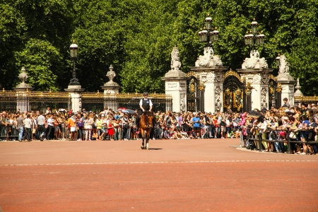 London, United Kingdom - July 28, 2013   Policeman on horse at Buckingham Palace  Tourists are waiting for the guards change  Editorial