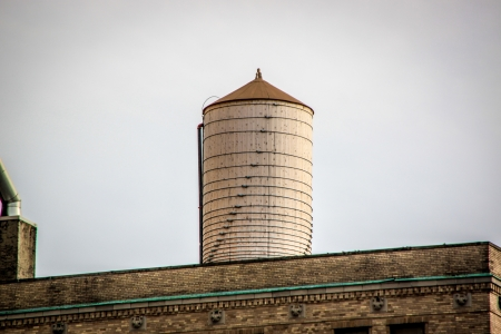 Rooftop water tower made of plain wood