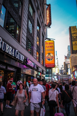 New York City, USA - August 8, 2012 People are walking by the Bubba Gump restaurant at Times Square
