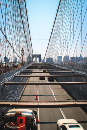 On the left people using the pedestrian way to cross the Brooklyn Bridge  Stock Photo