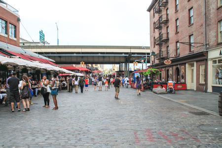 weehawken: New York, USA - August 11, 2012 , 2012 People are walking on a the paved part of Fulton Street near Pier 17