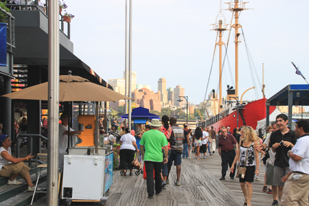weehawken: New York, USA - August 11, 2012 , 2012 People are walking on Pier 17