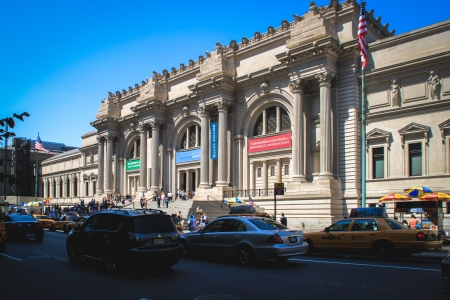 New York, USA - August 12, 2012 People are walking to the entrance of the Metropolitan Museum of Art in Manhattan located on the eastern edge of Central Park along Manhattan