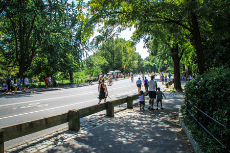 New York, USA - August 12, 2012 People are enjoying a sunny day in Central Park, New York  A good place to bring the children, to go walk the dig, to do some sport
