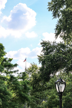 American flag on the top of the Belvedere Castle in Central Park, New York  Stock Photo