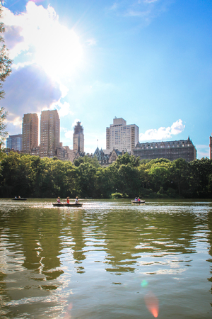 New York, USA - August 12, 2012 Some people on the Lake in Central Park are sailing on small punts  Stock Photo