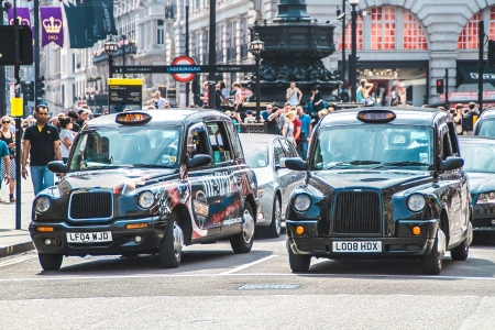 London, United Kingdom - July 23, 2013  London cabs at Piccadilly Circus