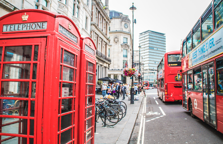 London, United Kingdom - July 23, 2013  London red phone boxes and double decker buses