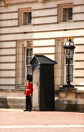 London, United Kingdom - July 28, 2013   A member of the Queens guard posted outside the Buckingham palace