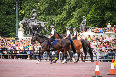 London, United Kingdom - July 28, 2013 Three mounted police officers during the guards change near Buckingham Palace