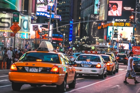 Taxi and police car at Times Square in New York