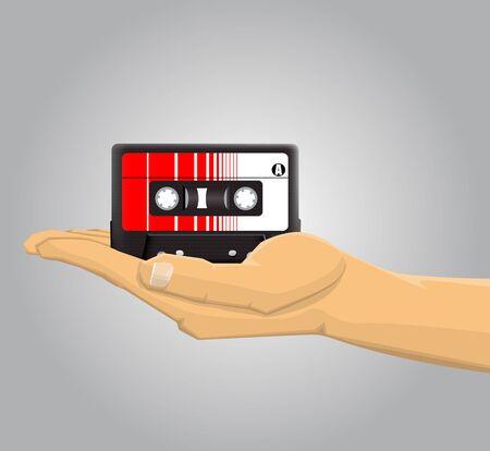 casette: Hand holding an audio casette