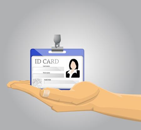 Mano que sostiene una tarjeta de identificación
