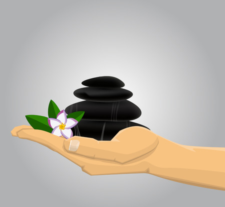 stacked stones: Hand holding Spa stones andflower