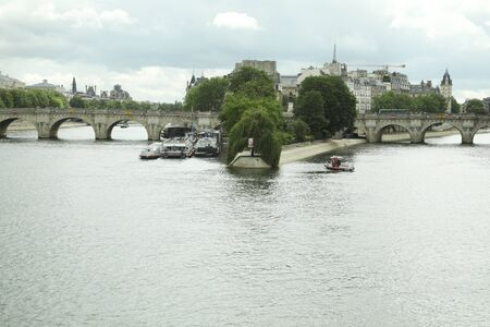 View of island Isle de la Cite with two bridges over the Seine river. Paris, France.