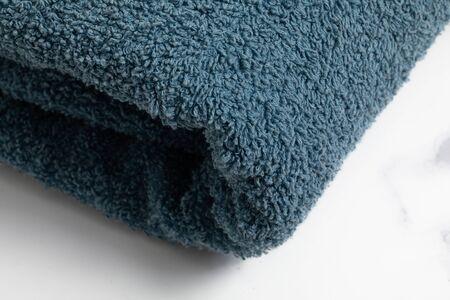 blue towel. Bath equipment studio shoot on white background