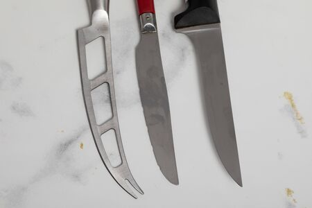 A professional isolated kitchen knife on a white marble background. steel kitchenware 版權商用圖片