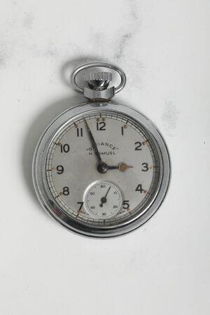 Pocket watch vintage clock . Chrome antique item on white