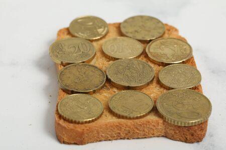 Money sandwich. Euros cents on toast bread on white background 版權商用圖片 - 147137656